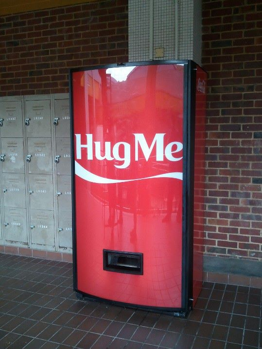 coke hug me machine