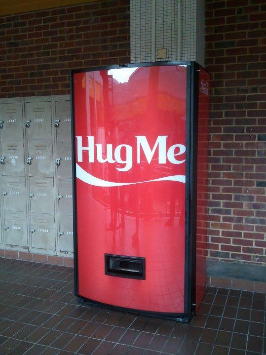 coke hug me machine
